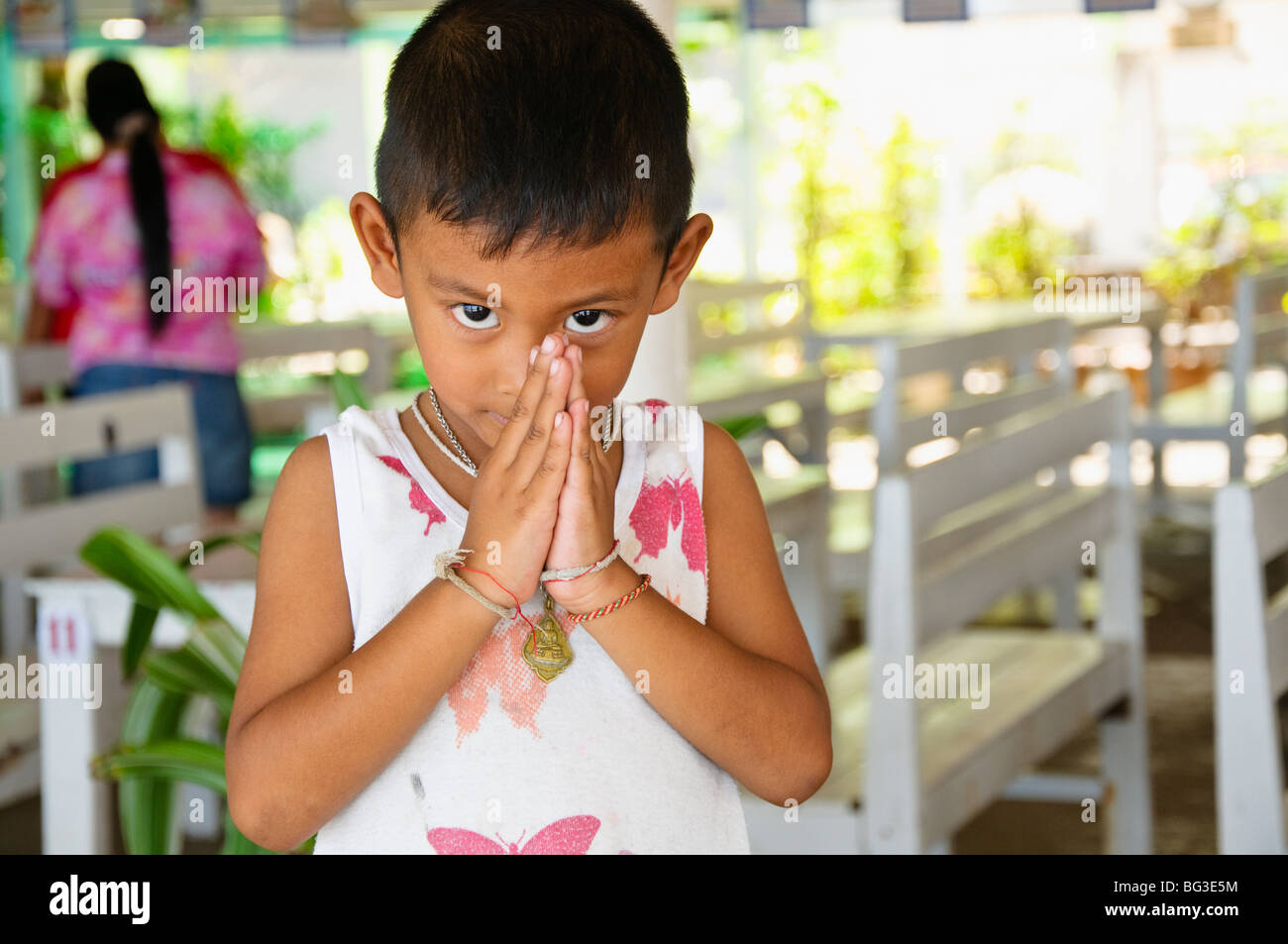 Wai greeting from a child, Ban Phe, Thailand - Stock Image