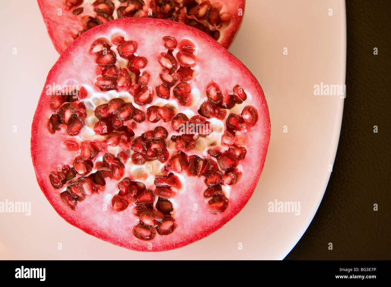 Freshly sliced pomegranate - Stock Image