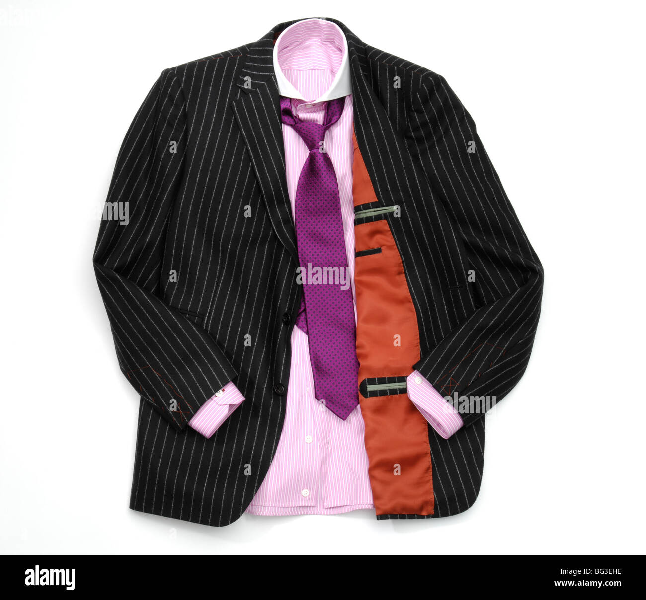 A mens suit - pink shirt, purple tie and black pin stripped black jacket. Stock Photo