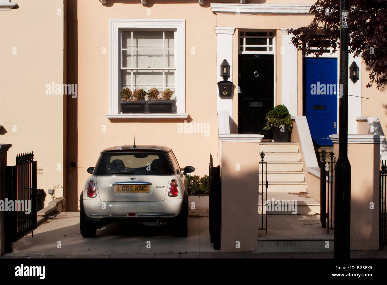 Front door of a house with a Mini car parked in the drive in Notting ...