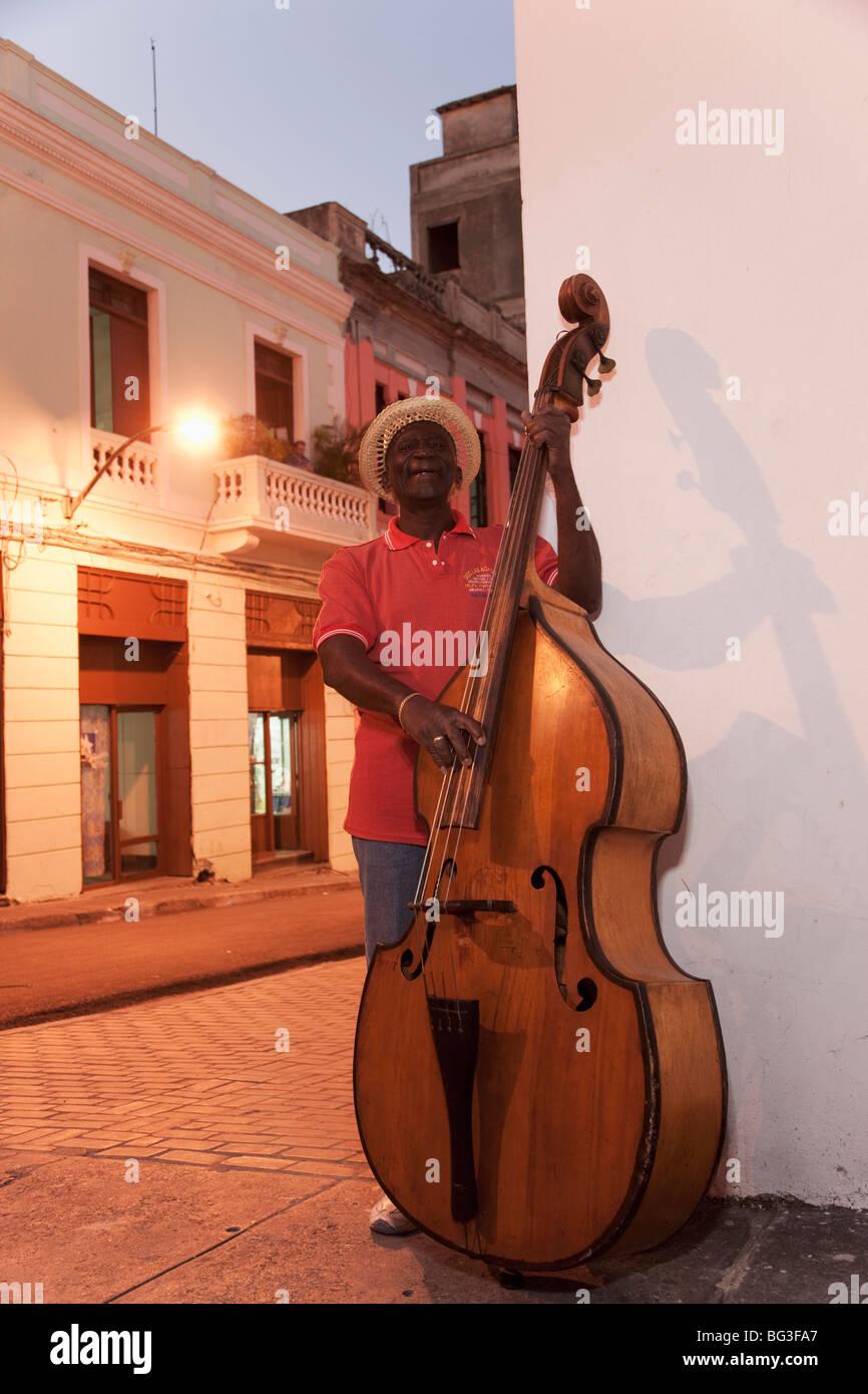 Bass player, Santiago de Cuba, Cuba, West Indies, Central America - Stock Image