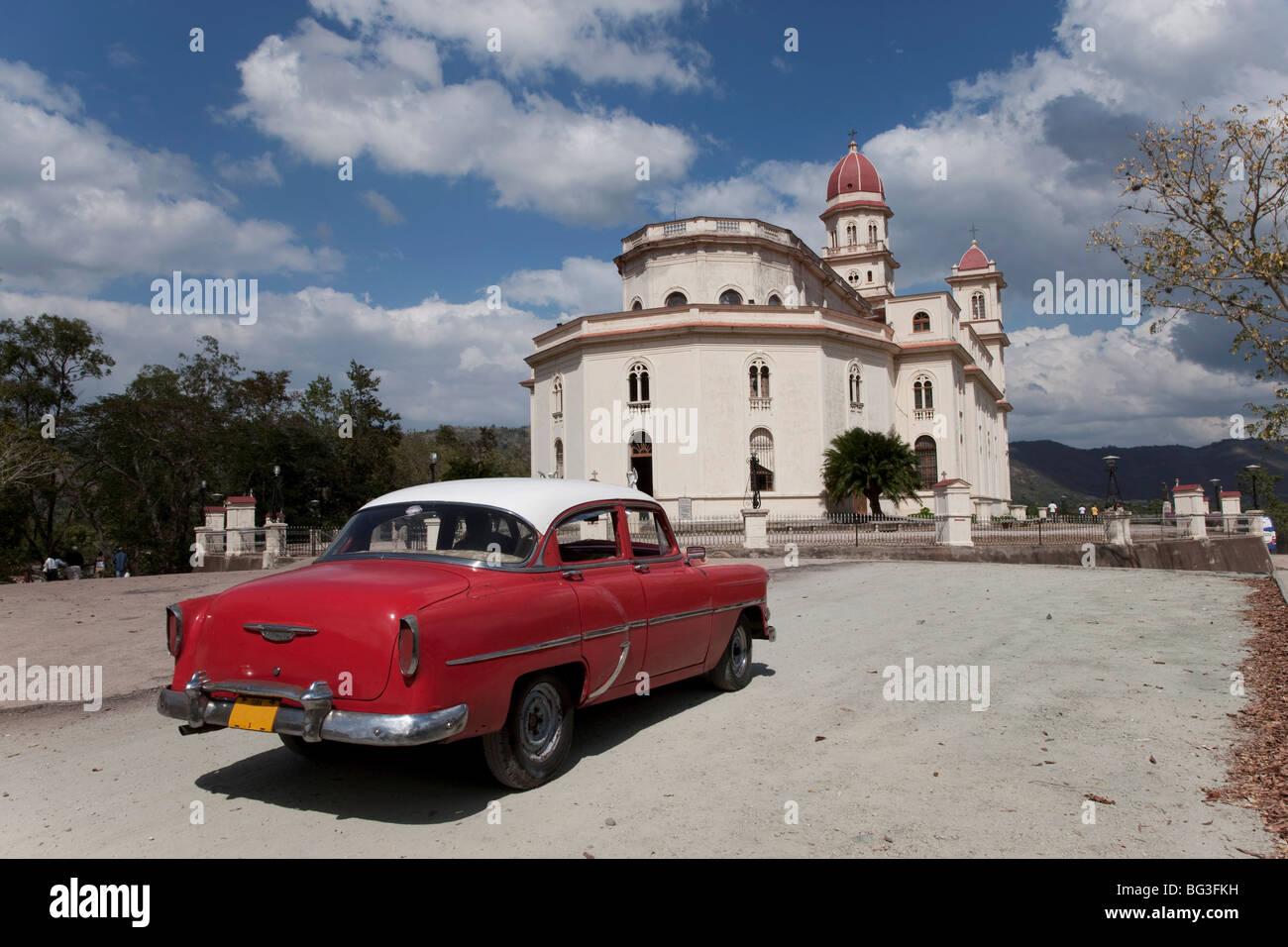 Old Chevrolet at the Church of Caridad del Cobre, Santiago de Cuba, Santiago de Cuba Province, Cuba, West Indies Stock Photo