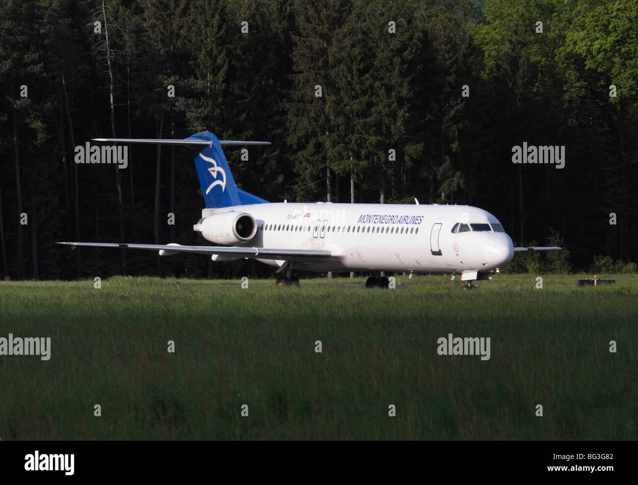 Montenegro Airlines Fokker 100 about to depart from Ljubljana Airport Stock Photo