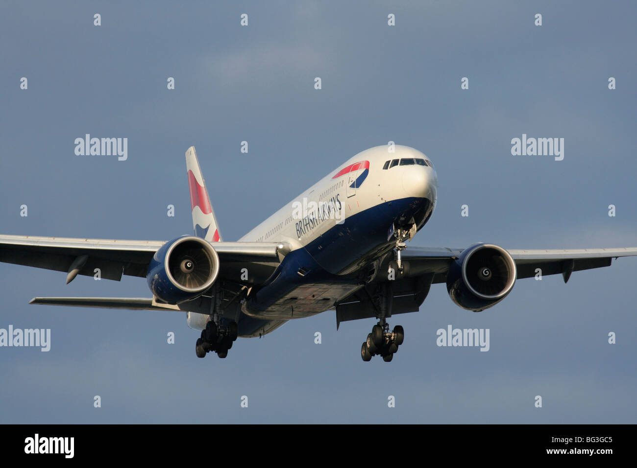 British Airways Boeing 777-200ER long haul twin engine passenger jet airliner on approach to Heathrow - Stock Image