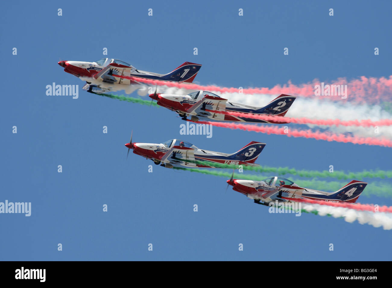 The Pioneer Team flying their Alpi Aviation Pioneer 300 Hawks in close formation - Stock Image
