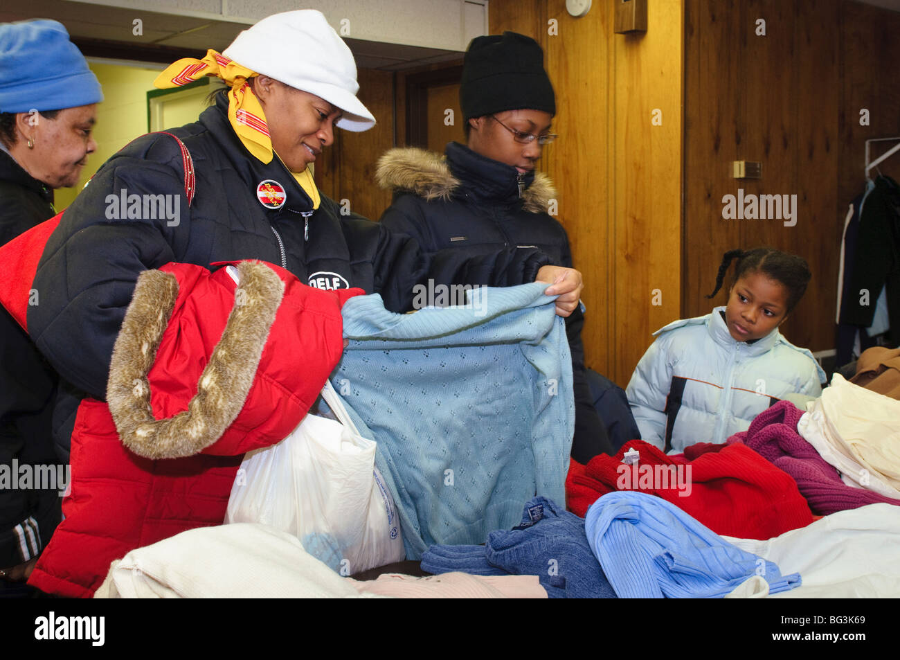 Community outreach clothing giveaway to help needy citizens. - Stock Image