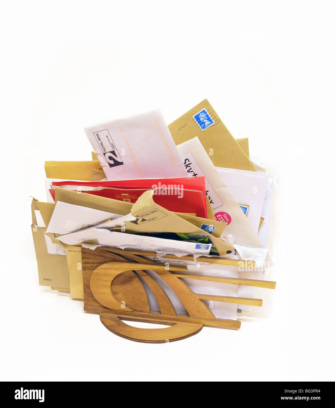 A cutout of a letter rack bulging with an assortment of received post. - Stock Image