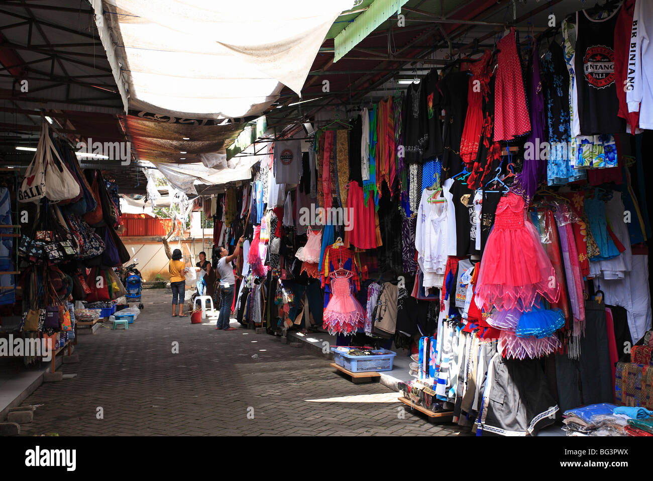 market stalls selling clothing, bags and homewares in a gang
