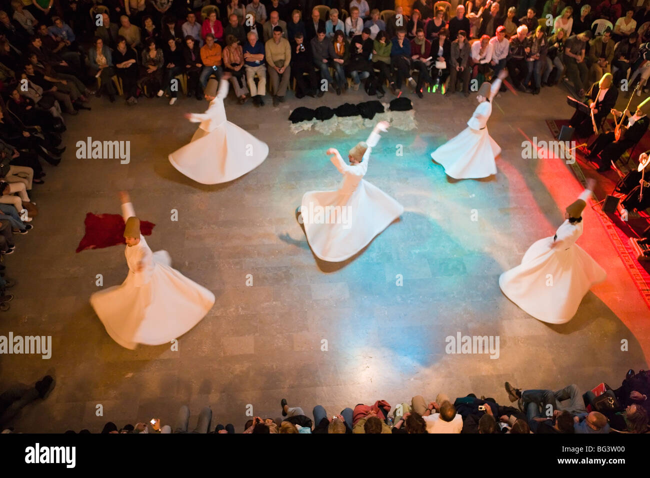 The Mevlevi, (Whirling Dervishes) performing the Sufi dance, Istanbul, Turkey, Europe Stock Photo