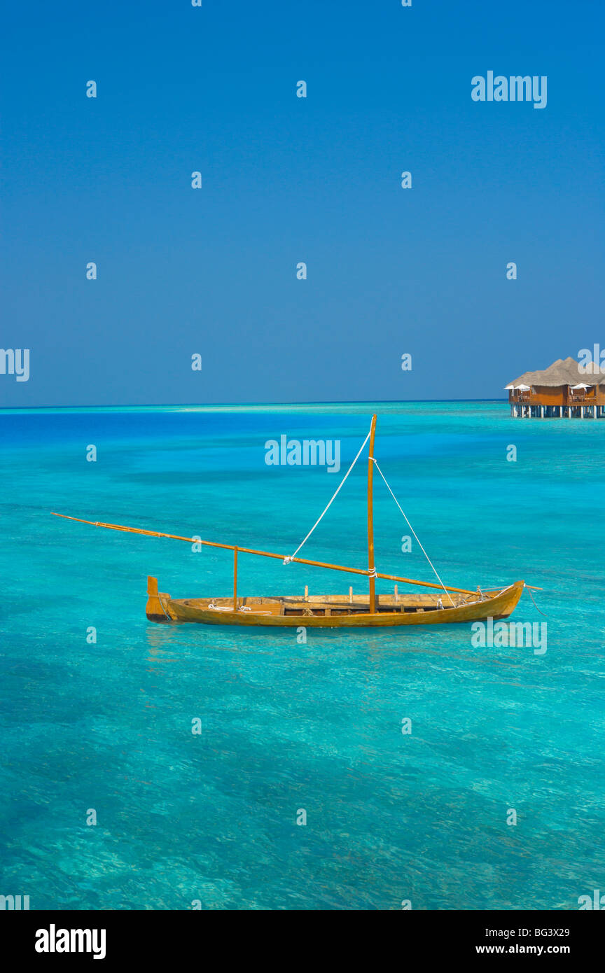 Taditional dhoni and water villas, Maldives, Indian Ocean, Asia - Stock Image
