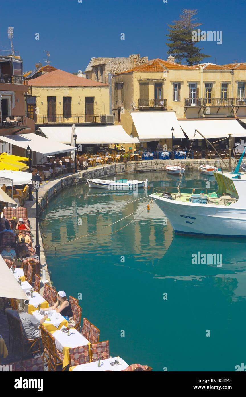 Old port and restaurants, Rethymnon, Crete, Greek Islands, Greece, Europe Stock Photo