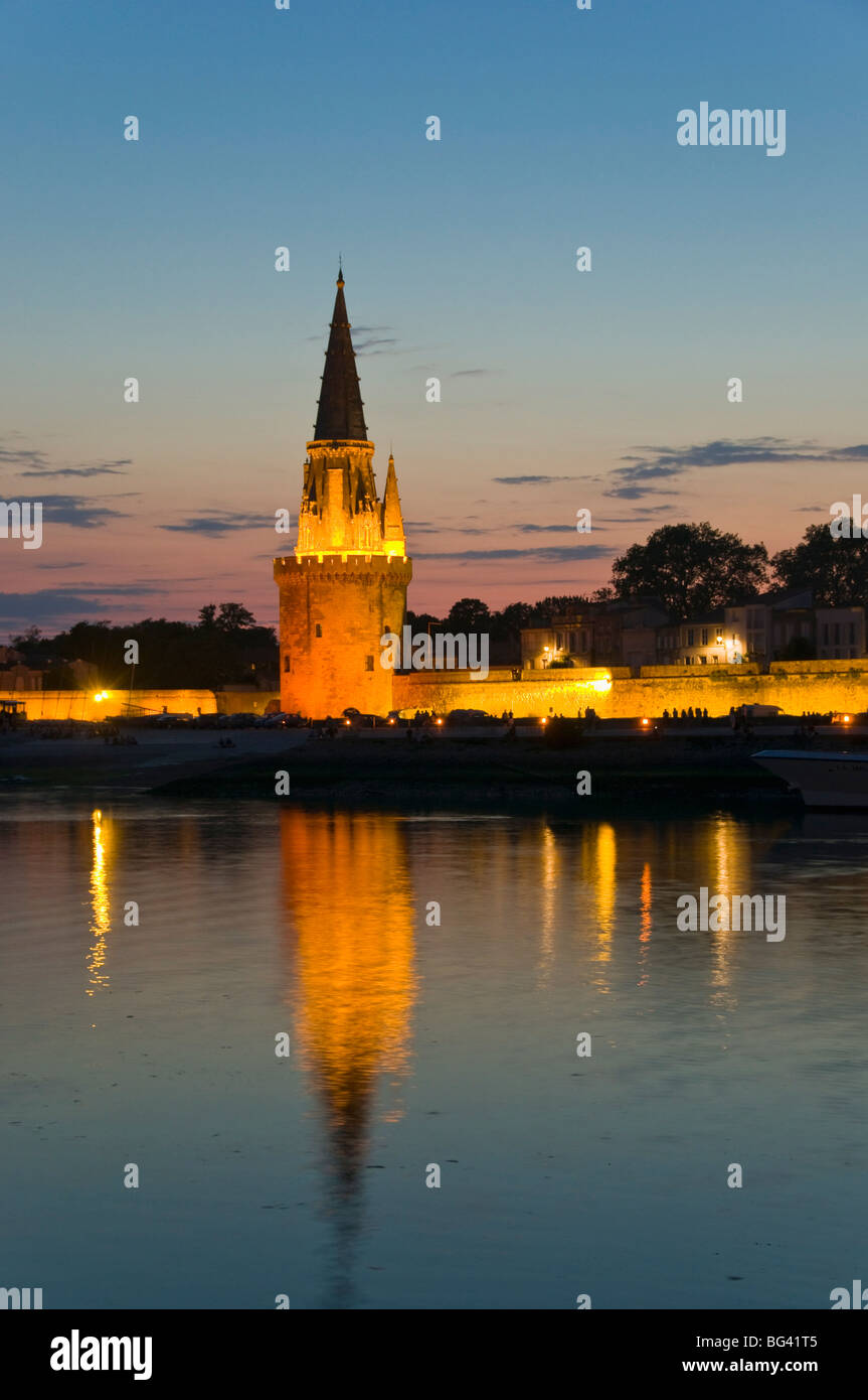 Old prison tower seen across the harbour entrance at dusk, La Rochelle, Charente-Maritime, France, Europe Stock Photo