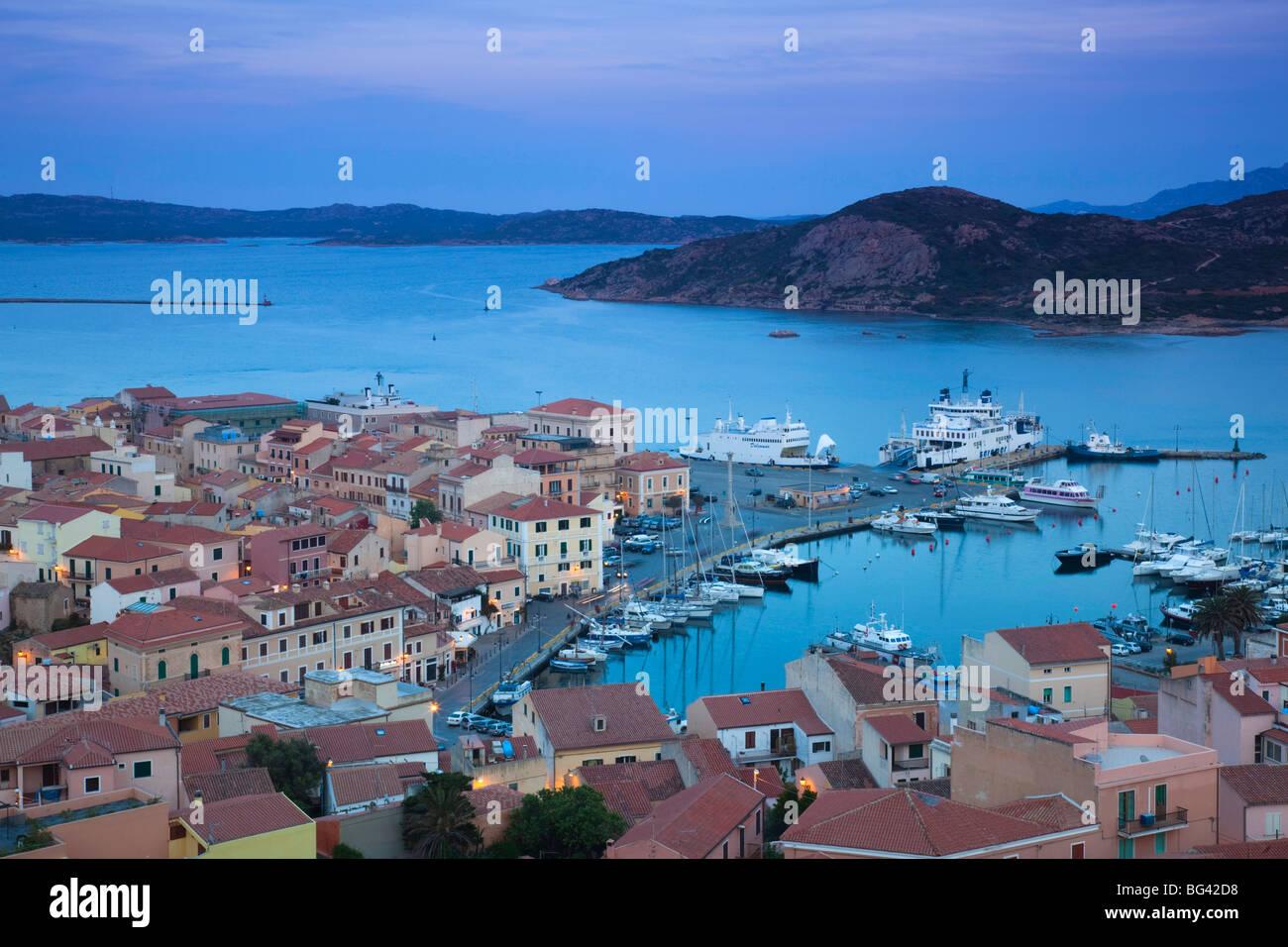 Italy, Sardinia, Northern Sardinia, Isola Maddalena, La Maddalena, aerial port view from the hills, dusk - Stock Image