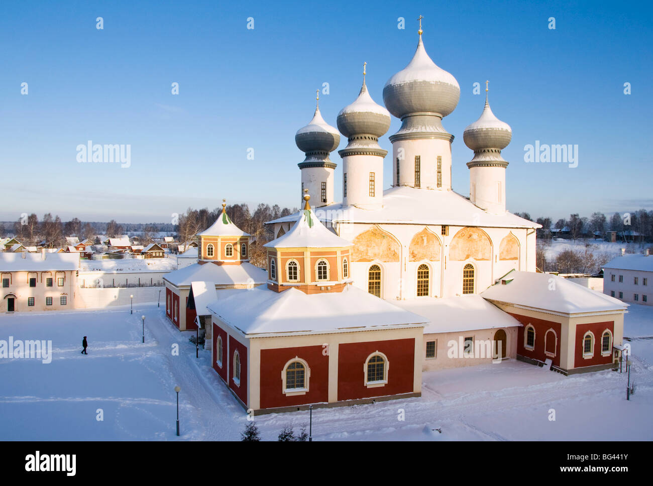Uspensky Cathedral with the old part of Tikhvin town in winter, Bogorodichno-Uspenskij Monastery, Leningrad region, - Stock Image