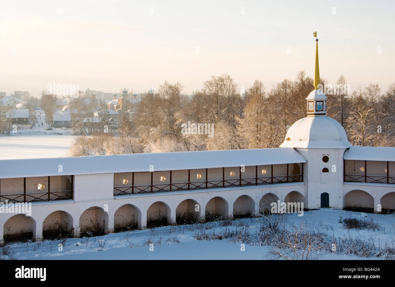 Walls of Bogorodichno-Uspenskij Monastery with town Tikhvin in the background, Leningrad region, Russia - Stock Image