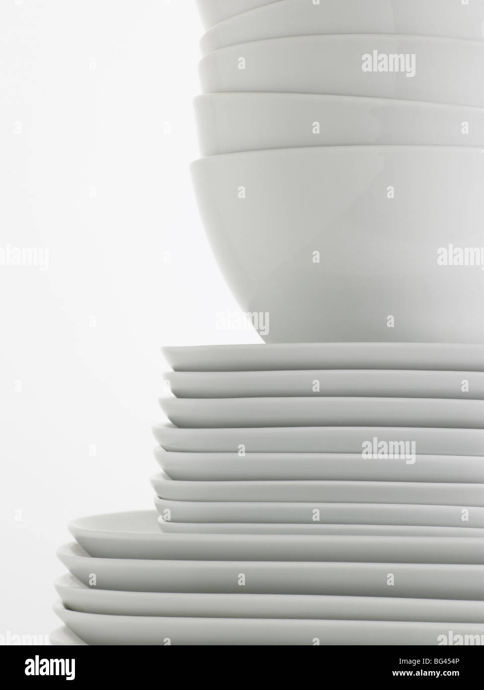 stack of white crockery - Stock Image