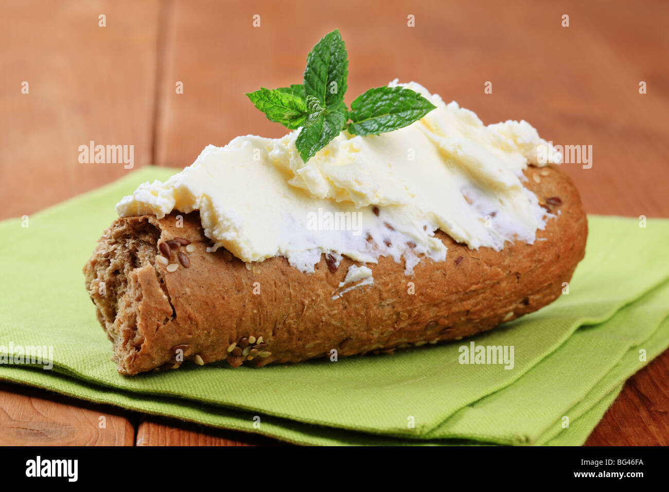 Whole wheat roll and savory spread - Stock Image