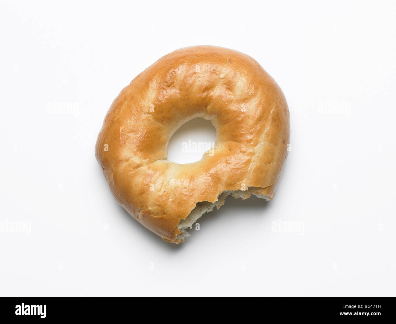 bagel with bite taken out - Stock Image
