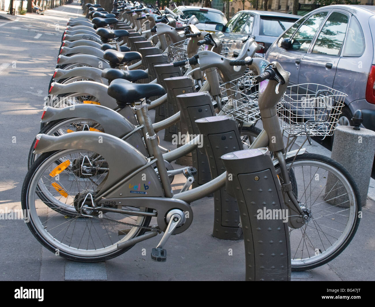 A row of cycles in Paris, France View from the side. Close up - Stock Image