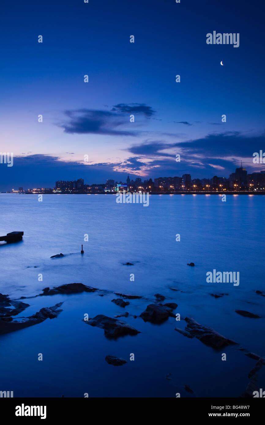 Uruguay, Montevideo, view from La Rambla, waterfront, dusk - Stock Image