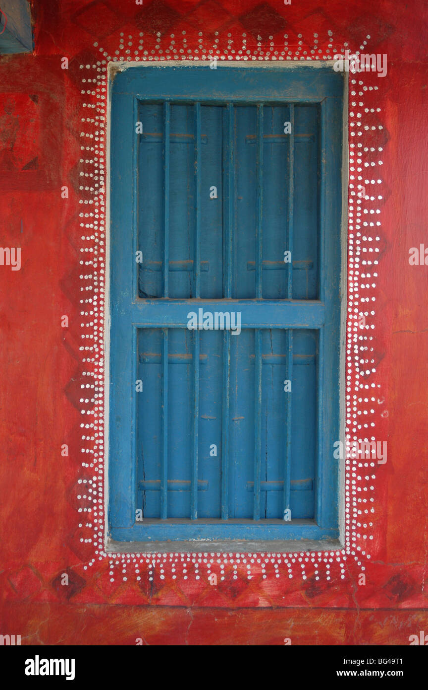 Decorated shuttered window in painted bhunga wall, Dhordo village, Kachchh, Gujarat, India, Asia - Stock Image