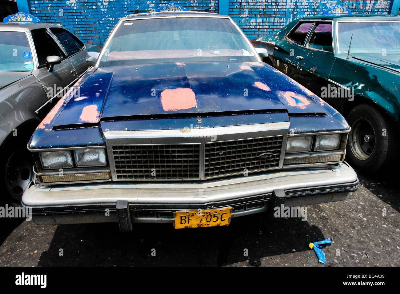 An American classic cars from 1970s, used as a shared taxi, parked ...
