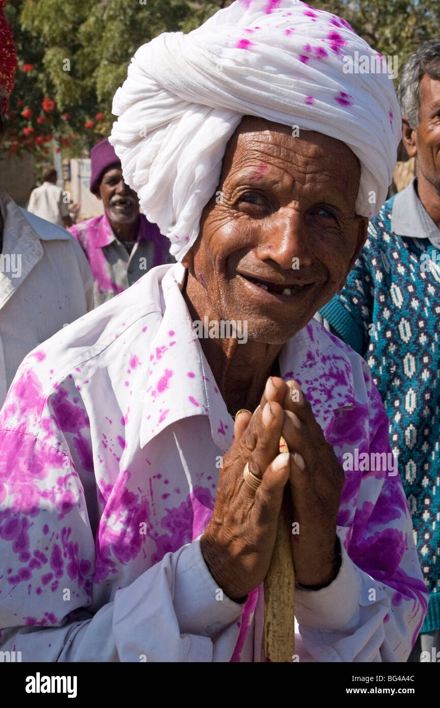 Man offering Namaste greeting on his way back from village wedding celebrations Ajmer district, Rajasthan, India - Stock Image