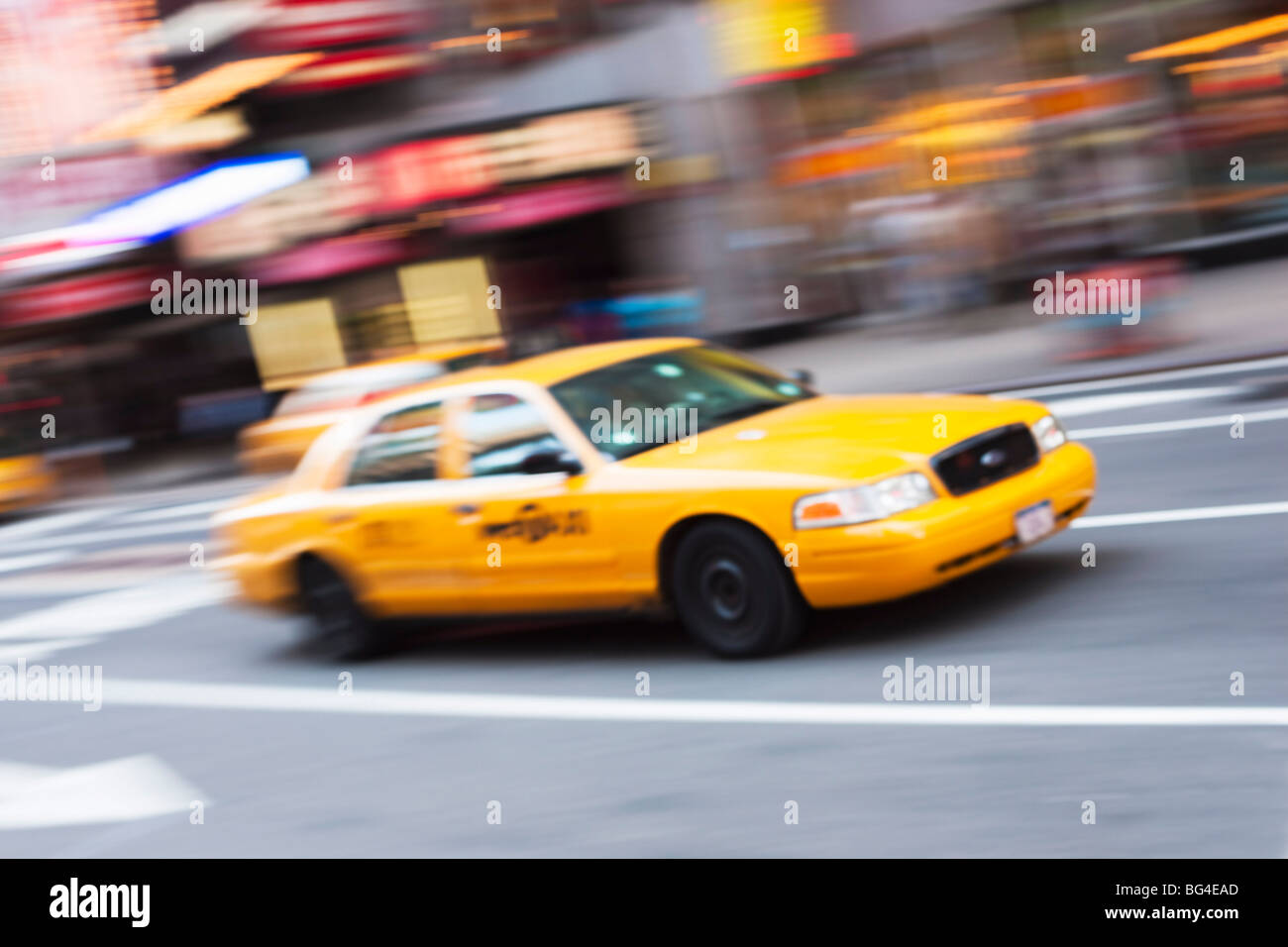 Taxi cabs in Times Square, Midtown, Manhattan, New York City, New York, United States of America, North America - Stock Image