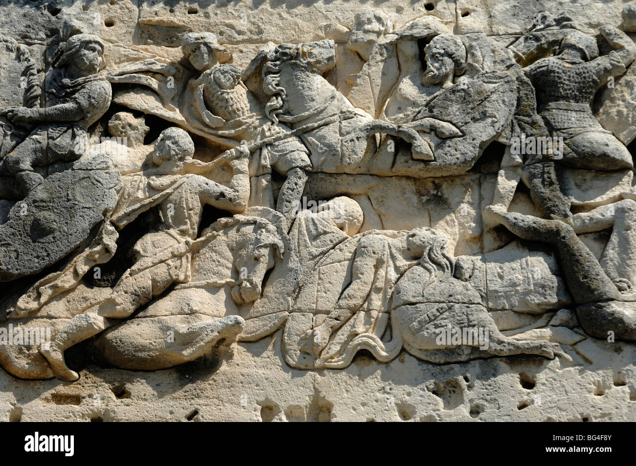 Roman & Gallic Soldiers in Battle Scene on Roman Arc de Triomphe or Triumphal Arch, Orange, Provence, France - Stock Image