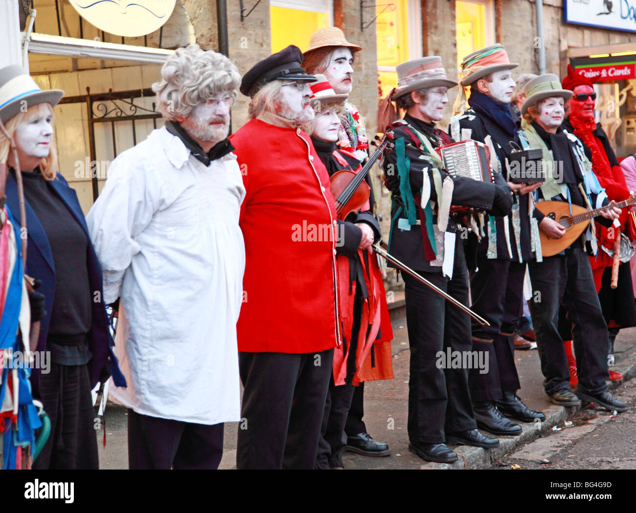 A group of traditional 'mummers' in a street performance during a Christmas fair in the UK - Stock Image