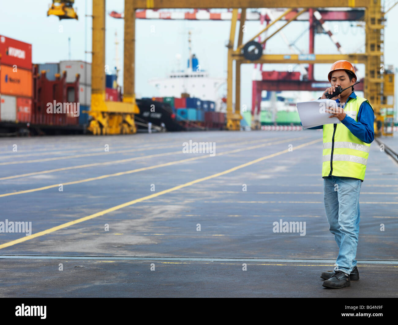 A man on the job, talking into a radio. Stock Photo