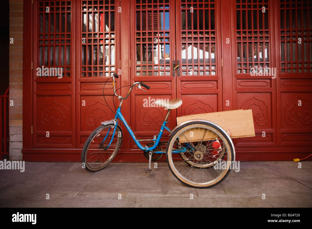Adult tricycle, International Buddhist Society Temple, Richmond, BC, Canada - Stock Image
