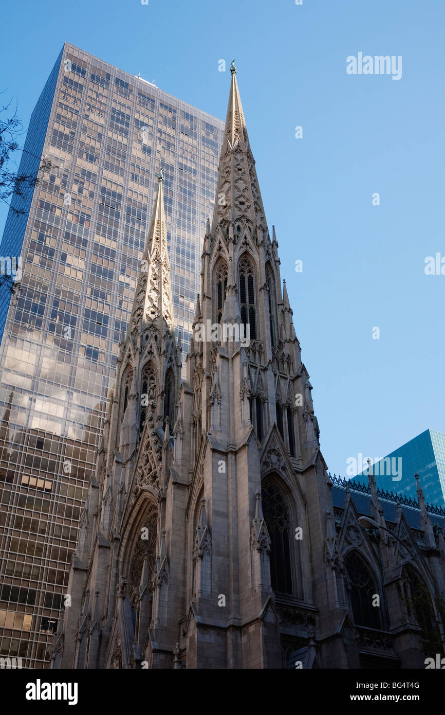 The Gothic architecture of Saint Patrick's Cathedral contrasts with the Olympic Tower building, Manhattan, New - Stock Image