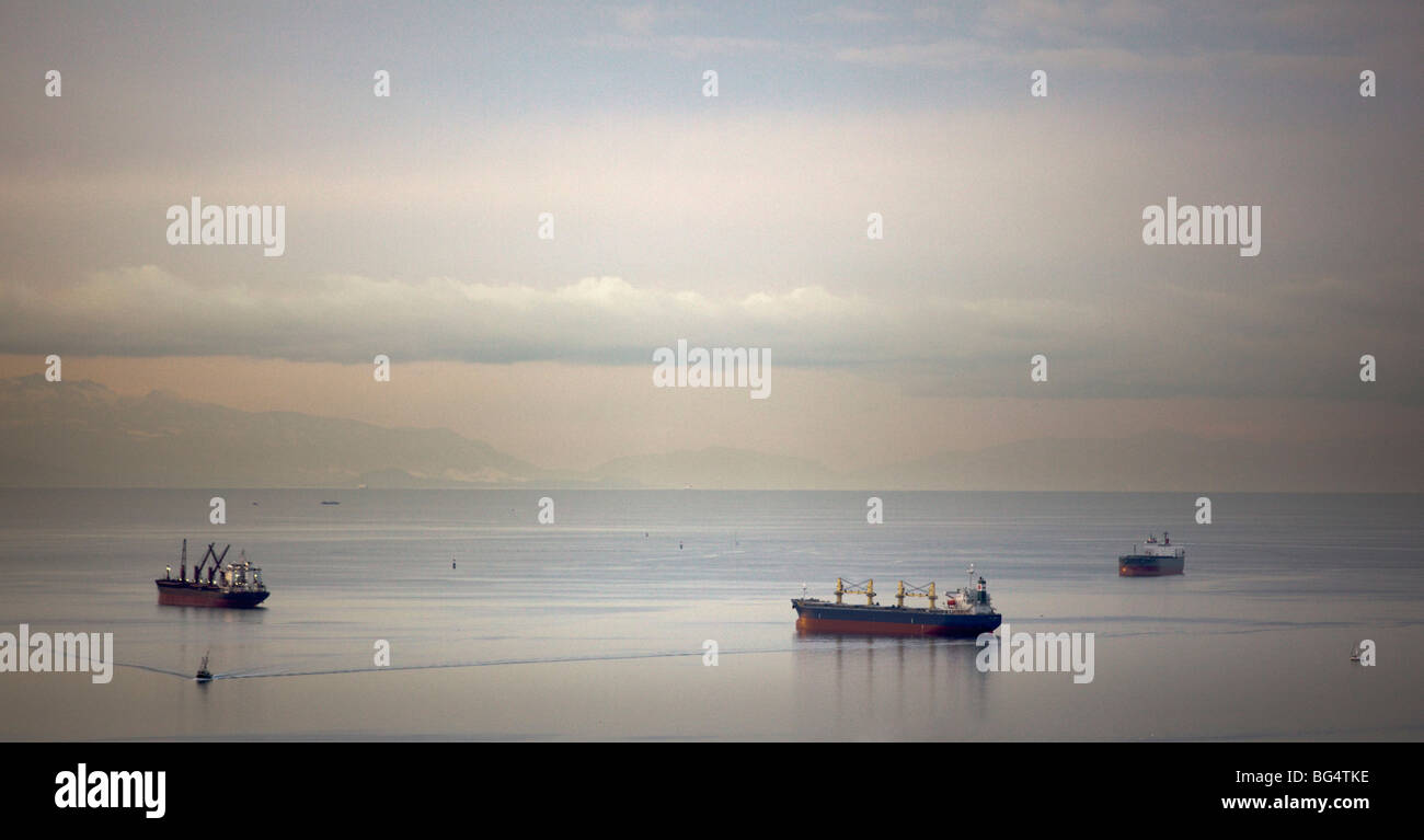 Bulk carrier cargo ships anchored in English Bay, Vancouver, BC, Canada - Stock Image