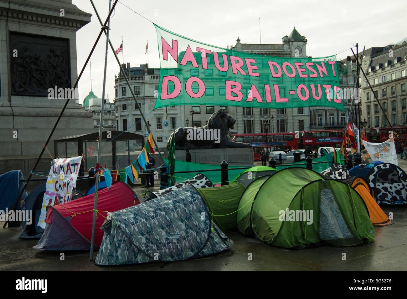 Climate change protestors at climatecamp, Trafalgar Square, London, England, UK - Stock Image