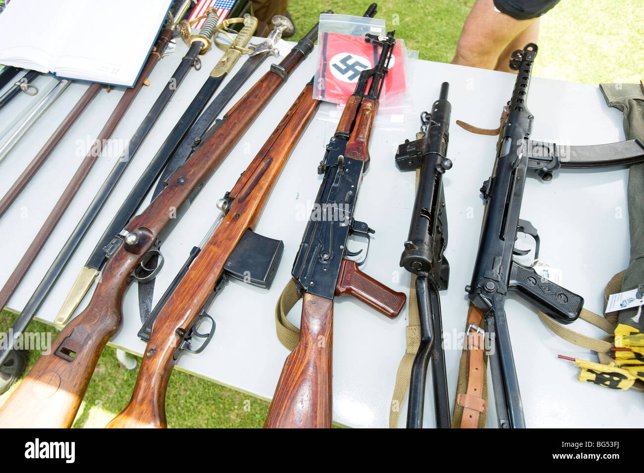 Deactivated military rifles for sale, with Swastika flag. South African Military History Museum. Johannesburb, South - Stock Image