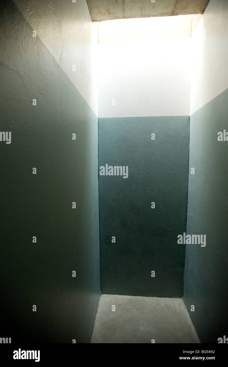 Solitary confinement cell at the Apartheid Museum. Johannesburg, South Africa. - Stock Image