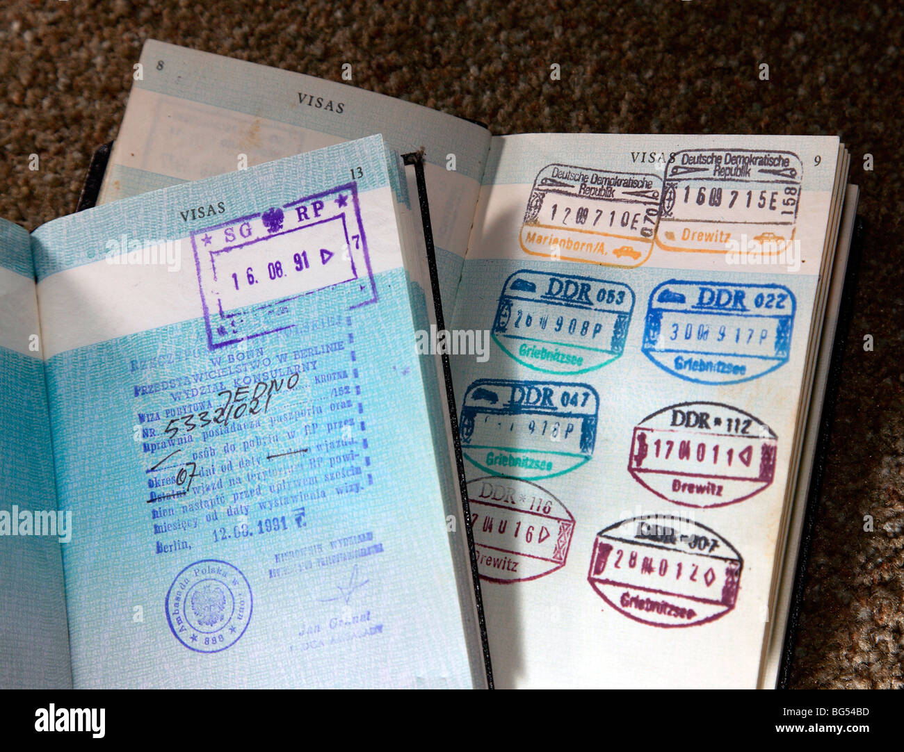 old visas in old style British passport - Stock Image