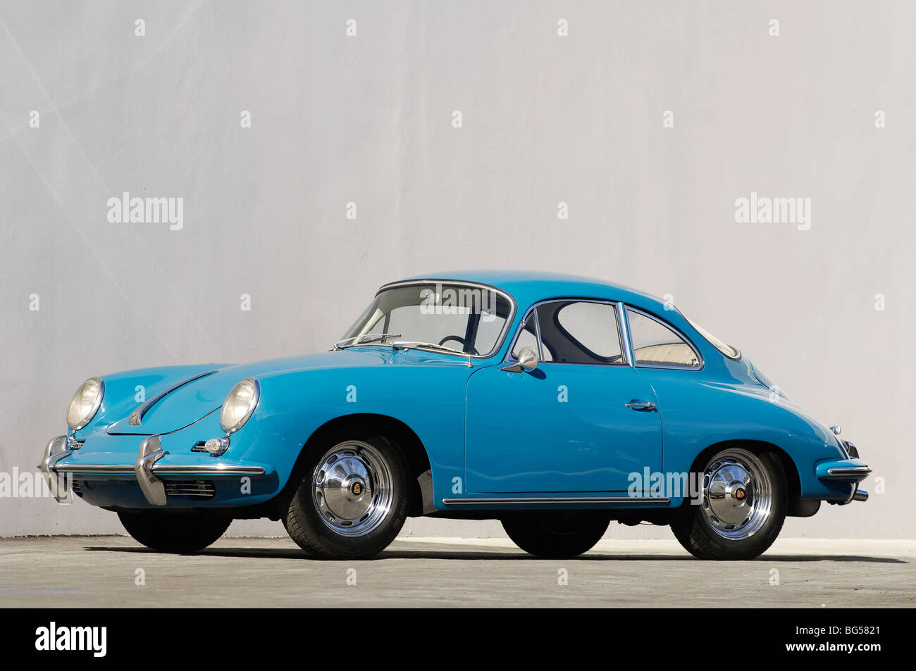 1963 Porsche 356b cope, front 3/4 view plain background in blue - Stock Image