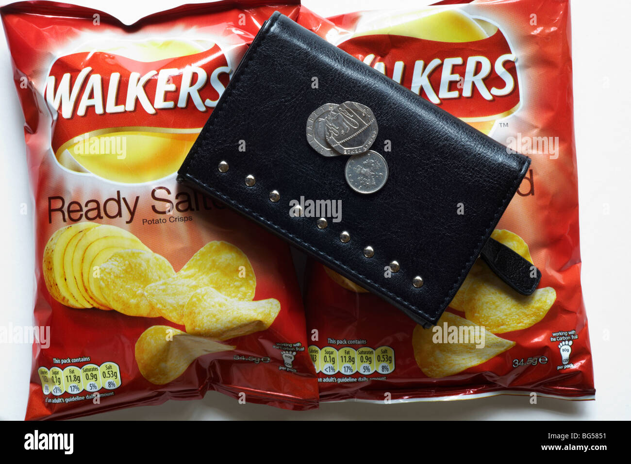 Two packets Walkers ready salted crisps and purse with money - Stock Image