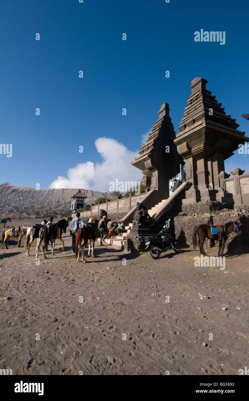Poten Hindu temple with Mount Bromo steaming in the background Stock
