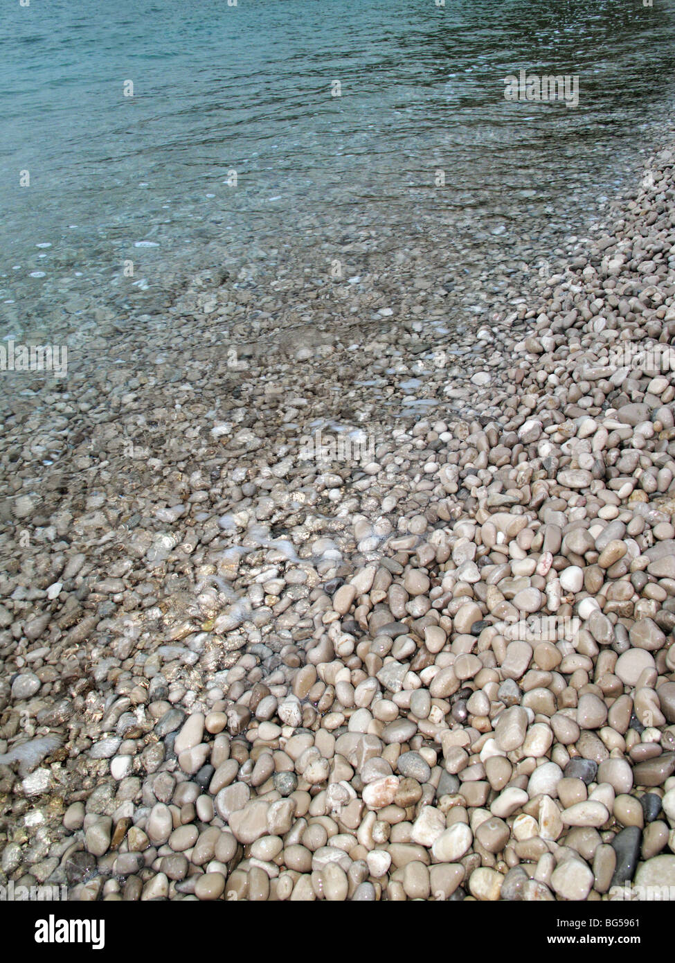 Close up of pebbled beach - Stock Image