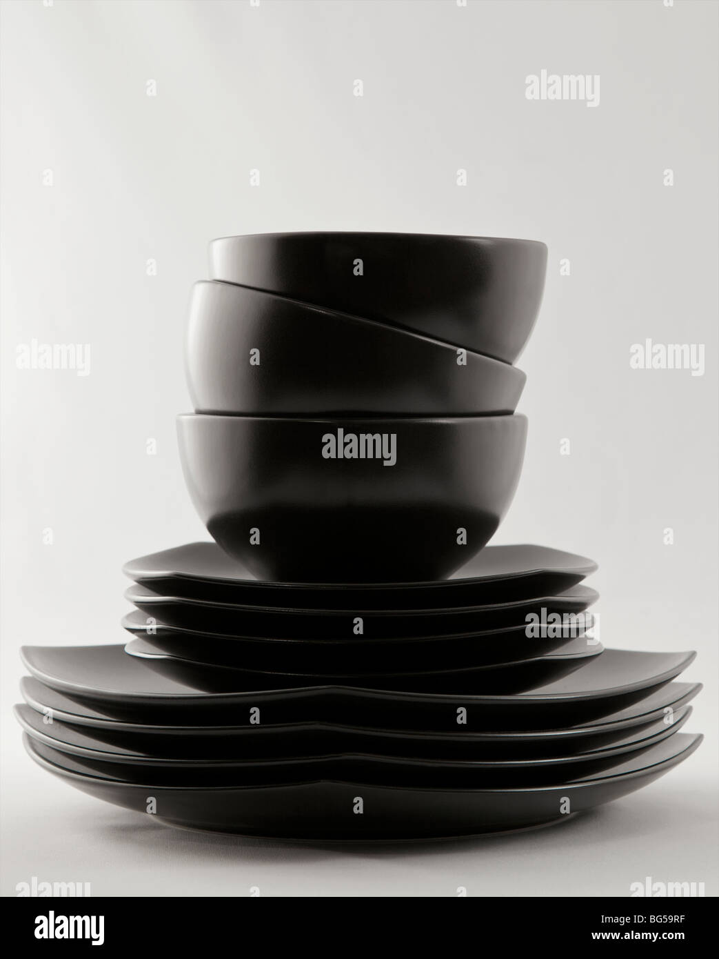 a stack of black dinner plates and bowls & a stack of black dinner plates and bowls Stock Photo: 27162339 - Alamy
