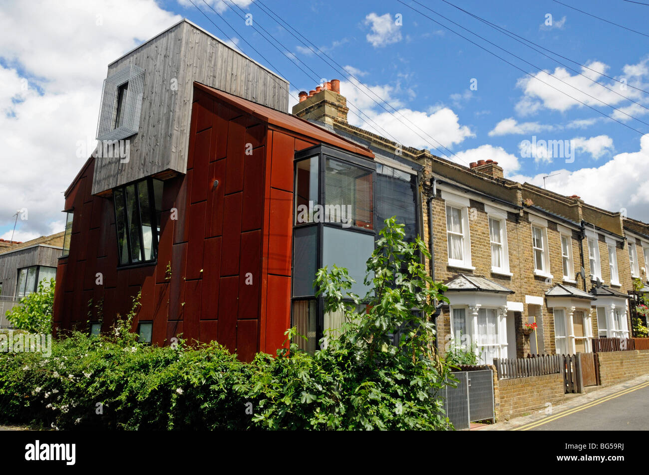 Modern house in street of old terraced houses highbury london england uk