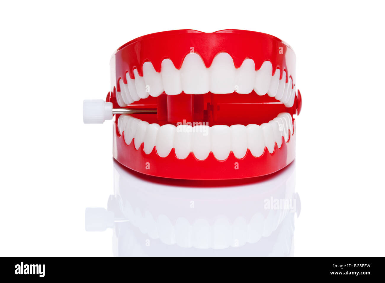 A pair of joke wind up chattering teeth on a pure white background, high resolution photo. - Stock Image
