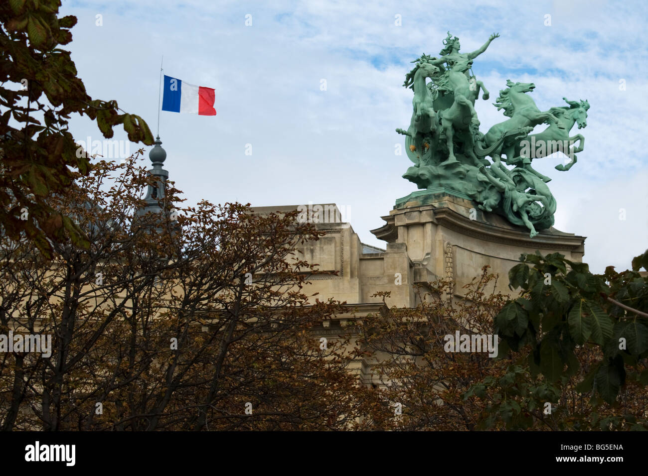 French flag and sculpture on the roof of Salon des Artistes Independants, Paris, France. - Stock Image