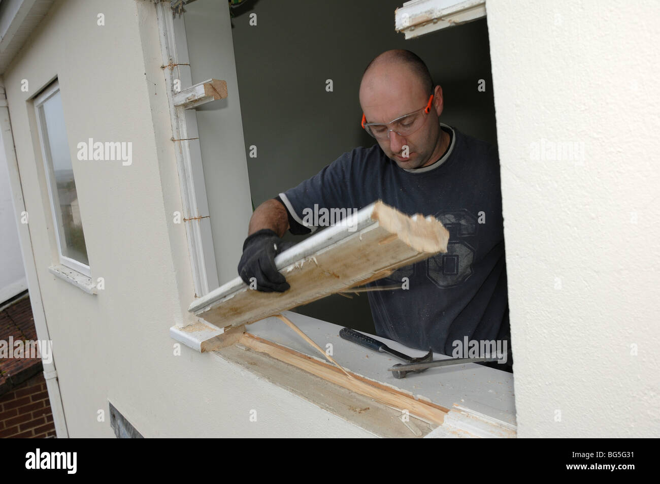 Removing old window frame before Installing new double glazed ... on