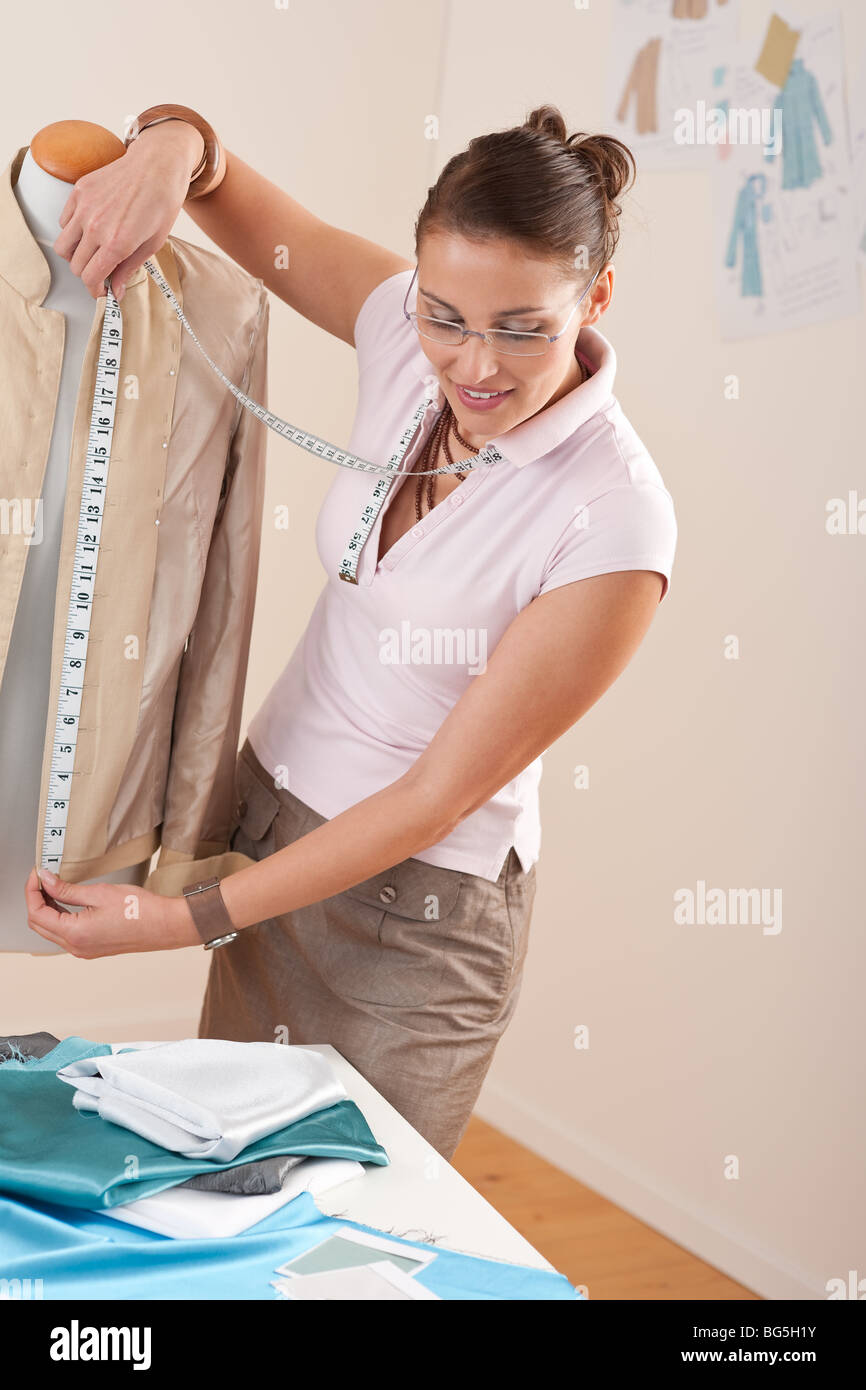 Successful Fashion Designer Woman Taking Measurement Of Jacket At Stock Photo Alamy