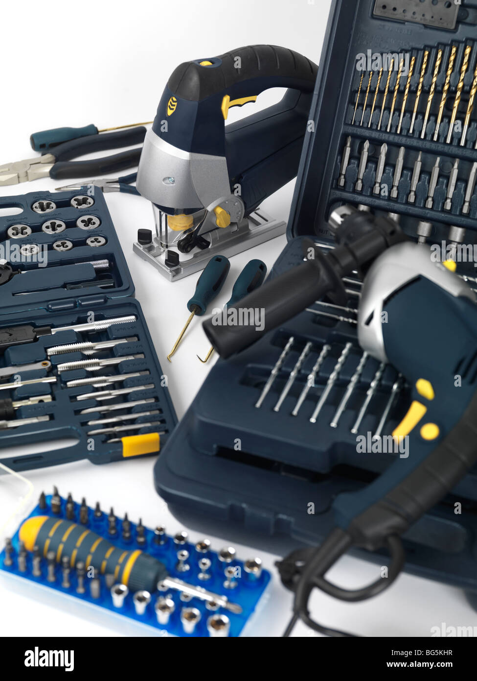 Electric drill, a jigsaw, thread cutting dies and taps, drill bits and other tools - Stock Image