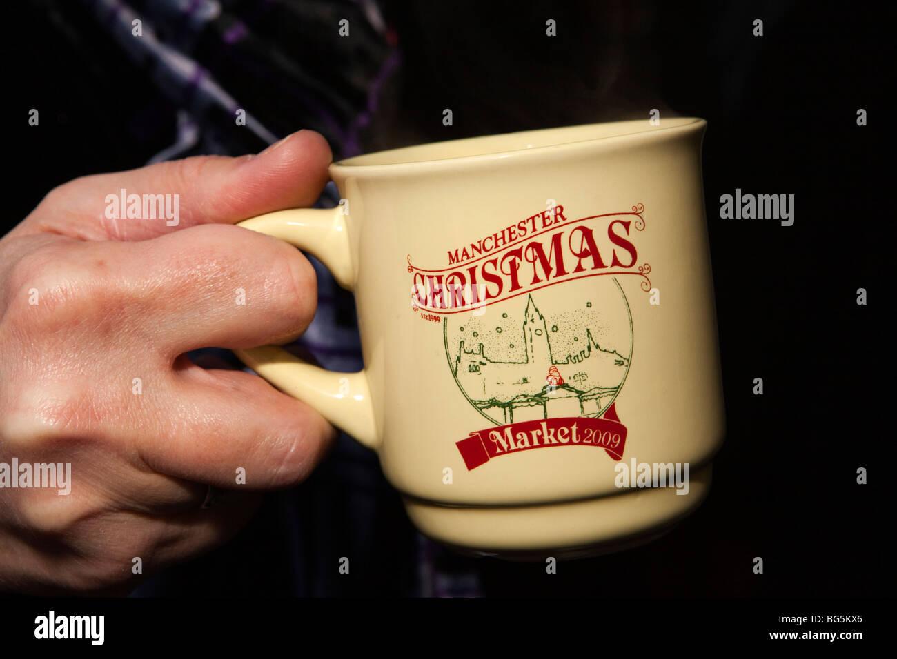 UK, England, Manchester, St Annes Square Christmas Market, hand holding commemoration mug - Stock Image